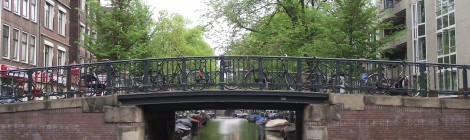 A Bridge Over A Canal In Amsterdam
