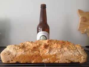 A flat loaf of pale ale bread.