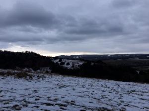 Snowy Hills Stormy Skies